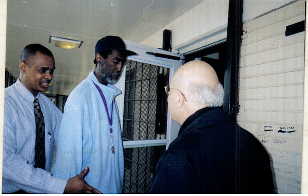 Cardinal George receives a warm welcome from Robert Taylor Residents
