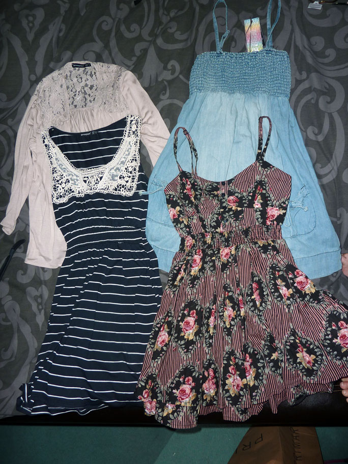 Outfit posts will most likely come later in the week but for now, here are  the dresses I bought, laid out on my bed!