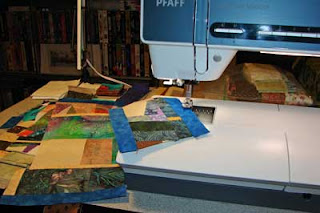 Here are some scraps being sewn into a crumb quilt.