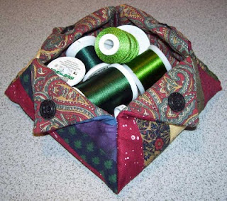 Another angle of this thread catcher, both have paisley lining the interiors of the containers.