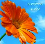Merci bien, Fly, for the gorgeous sunshine award