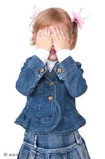 little girl hides face