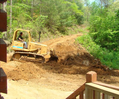 Using a bulldozer to remove stumps