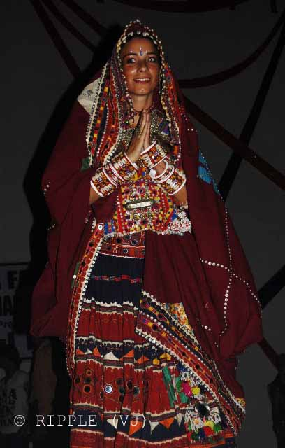 Bridal Competetion for Tourists @ Pushkar Camel Fair - 2008: While visiting Pushkar, I chanced upon a Bridal Competition where young foreign girls dressed in beautiful Indian bridal dresses, contemporary and traditional. Till very recent past, it was a norm to use maroon (a deep red) fabric for a bridal dress in north India. However, recently, designers and brides have started experimenting with new colors, such as Golden, Green, Orange etc.: Posted by VJ on PHOTO JOURNEY @ www.travellingcamera.com : VJ, ripple, Vijay Kumar Sharma, ripple4photography, Frozen Moments, photographs, Photography, ripple (VJ), VJ, Ripple (VJ) Photography, VJ-Photography, Capture Present for Future, Freeze Present for Future, ripple (VJ) Photographs , VJ Photographs, Ripple (VJ) Photography : This bride is amused by her getup. Apart from being dressed up in a red embroidered lehenga, and chunky golden jewellery, she's also holding a 'Varmala' which is a garland made of roses and rajnigandha and other fragrant flowers.A bride in the traditional Rajasthani Bridal Dressup. You do not need to look too closely to figure out the difference. The patchwork lehenga in bold colors along with white painted jewellery is a trademark of Rajasthan. The white jewellery was traditionally made of ivory. But Ivory from the Endangered Indian Elephants is now banned.