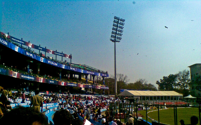 Mobile Clicks of IPL Match between Delhi DareDevils and Chennai Super Kings on 19th March 2010 @ Firoz Shah Kotla, Delhi, INDIA: Posted by VJ on PHOTO JOURNEY @ www.travellingcamera.com : VJ, ripple, Vijay Kumar Sharma, ripple4photography, Frozen Moments, photographs, Photography, ripple (VJ), VJ, Ripple (VJ) Photography, VJ-Photography, Capture Present for Future, Freeze Present for Future, ripple (VJ) Photographs , VJ Photographs, Ripple (VJ) Photography :  I don't follow cricket and but know few players who have big name in the world of Cricket. On Friday we had an office outing to Firoz Shah Kotla to watch IPL Match between Delhi DareDevils and Chennai SuperKings...Cameras were not allowed inside the stadium :(  But I managed with my Nokia Phone :): This Stadium was originally a fortress built by Sultan Ferozshah Tughlaq to house his version of Delhi city called Ferozabad. A pristine polished sandstone pillar from the 3rd century B.C. rises from the palace's crumbling remains, one of many pillars left by the Mauryan emperor Ashoka; it was moved from Punjab and re-erected in its current location in 1356. The Feroz Shah Kotla was established as a cricket ground in 1883. The first test match at this venue was played on November 10, 1948 when India took on the West Indies. Anil Kumble took 10 wickets in an inning on this ground in 1999, only the second time this feat has been achieved in test cricket. It is owned and operated by the DDCA (Delhi District Cricket Association). Since 2008 the stadium has been the home venue of the Delhi DareDevils of the Indian Premier League. On 27th December 2009, an ODI match between India and Sri Lanka called off because pitch conditions were classed as unfit to host a match. The ICC is currently conducting an investigation, and a possible sanction could include the Feroz Shah Kotla being rejected as a venue for the 2011 Cricket World Cup.