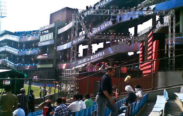 Mobile Clicks of IPL Match between Delhi DareDevils and Chennai Super Kings on 19th March 2010 @ Firoz Shah Kotla, Delhi, INDIA: Posted by VJ on PHOTO JOURNEY @ www.travellingcamera.com : VJ, ripple, Vijay Kumar Sharma, ripple4photography, Frozen Moments, photographs, Photography, ripple (VJ), VJ, Ripple (VJ) Photography, VJ-Photography, Capture Present for Future, Freeze Present for Future, ripple (VJ) Photographs , VJ Photographs, Ripple (VJ) Photography : I don't follow cricket and but know few players who have big name in the world of Cricket. On Friday we had an office outing to Firoz Shah Kotla to watch IPL Match between Delhi DareDevils and Chennai SuperKings...Cameras were not allowed inside the stadium :(  But I managed with my Nokia Phone :): This Stadium was originally a fortress built by Sultan Ferozshah Tughlaq to house his version of Delhi city called Ferozabad. A pristine polished sandstone pillar from the 3rd century B.C. rises from the palace's crumbling remains, one of many pillars left by the Mauryan emperor Ashoka; it was moved from Punjab and re-erected in its current location in 1356. The Feroz Shah Kotla was established as a cricket ground in 1883. The first test match at this venue was played on November 10, 1948 when India took on the West Indies. Anil Kumble took 10 wickets in an inning on this ground in 1999, only the second time this feat has been achieved in test cricket. It is owned and operated by the DDCA (Delhi District Cricket Association). Since 2008 the stadium has been the home venue of the Delhi DareDevils of the Indian Premier League. On 27th December 2009, an ODI match between India and Sri Lanka called off because pitch conditions were classed as unfit to host a match. The ICC is currently conducting an investigation, and a possible sanction could include the Feroz Shah Kotla being rejected as a venue for the 2011 Cricket World Cup. DJ Stage @ Feroz Shah Kotla, DELHI I assume this was IPL arrangement and the song they were playing were very biased. Most of the viewers may ignore because they were cheering for Delhi but I personally didn't liked it...