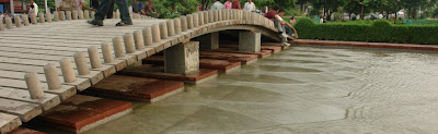 Water flowing under a small wooden bridge @ Central Park, Cannaught Place