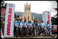Starting of MBT Himachal 2010 from Shimla: A Famous Bike Riding Experience in Himalayas : Posted by VJ SHARMA on www.travellingcamera.com : During November I published few photographs of MTB Himachal 2010 and here are few photographs of opening ceremony on Ritz (Ridge) ... In case you have missed my last post, please have a look at http://phototravelings.blogspot.com/2010/11/glimpses-of-hercules-mtb-himachal-2010.html : Warming up sessions on Mall Road of Shimla... Its morning of 22nd October when MTB race had to starteveryone was just ensurin the cycles have been assmbled properly and they are fit to start...All participants ready for the beginning ... Race started from the christ church on Ridge Ground in Shimla... First strech was free ride which means that time will not be noted during this stretch and everyone can ride as per his/her own choice without any pressure of reaching early...One of the reporters covering the event on Ridge ground of Shimla... Rider standing on the left is Padam who has come from Nepal with a group of other riders... Padam is the winner of MTB 2008 and 2009... Unfortunately his year he got ingured and was not able to continue the race after third day... Winner of 2010 is also trained by Padam and he was very happy on final day that one of his group won the race..Here is Mr. Suresh Bhardwaj, MLA Shimla... Mr bhardwaj was invited for innogration of MTB Himachal 2010... He flagged off the race from Ridge Ground in Shimla...Madhu Sood was also present during the starting of this event.. Madhu Sood is mayor of Shimla Town...On first day everyone was excited and everyone was in clean dresses :-) There were few riders, who were there for first two days and same was the story with Photographers.. Many of the Photoquest participants came back on third and we were only four who continued the journey till end... People who came back after second day, missed lot of beautiful places/experinces of these 8 days...