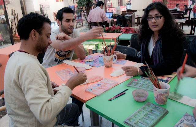 Wonderful day outing @ Color Factory in DLF Mall, Saket, Delhi : Posted by VJ SHARMA on www.travellingcamera.com : Recently our team got an opportunity to try their hands at painting at a team outing. It wasn't an easy task but all of them came up with masterpieces of their own by the end of it.This was a sample of the mask that we were supposed to come up with.The tools that we were supposed to use.The cups that contained the brushes were apparently created by painters very much like us.There were several painted cups and the paintings were like modern art. I am not sure that this was the intention of the painters though.People at various stages of their artistic journeys - Nandan already hard at work, Ankit picking up the brush, Priyanka waiting for an inspiration. :-)Inspiration struck!! Why's Ankit's face so blue?Some people looked very much at ease with the task at hand though. I don't know what Nandan is scratching off his face here...At last some face-colored faces!!!Natural progression from Ankit's blue face to Anurag's purple one...Beautiful...Some are born with natural talents of making people go green...A rude face sticking its tongue out... Nice shades of Blacks...Its amazing how many different expressions you can convey with exactly the same face structures...Courtesy the colour factory...Now its time to have lunch and Big Chill !!!
