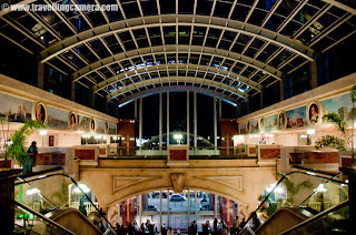 I am sure that you must have heard of UB City in Banglore, INDIA.. if not, check out http://phototravelings.blogspot.com/2011/01/photo-journey-of-unimaginable-luxury-of.html ... It's a wonderful places with lot of top brand showrooms, excellent quality restaurants, Bars, Multi-cuisine food-stalls, premium service apartments, high profile offices and what not !!! As name tells, its developed by UB Group of Vijay Malya !!!  : During my recent visit to Banglore, I visited UB city which known as biggest mall in Banglore City. Here are few photographs of UB City with few details a bout it... Check out !!!Here is entry to the parking of UB city in Banglore ... On entering into the parking, we parked our Maruti Also in the middle of BMW and Bentley !!! I wanted to click a photograph but it was not allowed inside the parking... 1100 cars can be parked at a time...UB City is considered as  biggest commercial property project in Bangalore, in Karnataka state of India. It is pioneered by the chairman of UB Group, Mr.Vijay Mallya. This whole complex is built on 13 acres of land On entering inside UB City, it looked like a 5 star hotel with Foreigners all around....UB City is located in the heart of Bangalore City. UB City is at corner of Vittal Mallya Road and Kasturba Road.... It's just 800 m. away from the famous M. G. Road in Baglore City...Children having fun near water fountains in the middle of UB City in Banglore..In UB city there are four towers named as - UB Tower, Comet, Canberra and Concorde... UB Tower has 19 Floors, Comet has 11 Floors and the name Comet is derived from an aircraft.. Same for the other two towers Canberra and Concorde, both of them are derived from an aircraft name. Canberra has 17 floors and Concorde has 19 floors...There are lot of resturants around an open area in the middle of this campus... Here is a photograph of The Tasty Tangles inside UB City... Its near to the open Amphitheater...I was told by someone that UB City has Group offices under one roof  of UB Towers. Concorde and Canberra have retail space on the lower floors and office space in the higher levels...But Comet has luxury serviced apartments...A photograph of a showroom of interiors ... Most of the brands there were very expensive and I heard of those first time. We came across a showroom of watches and mobiles.. though of looking at their products... First two mobiles we saw their were having price tag of 5.66 Lacs and 3.45 Lacs... I forgot the name of that brand.Comet tower has some commercial offices, banks, high-end retail stores, a five star hotel, luxury service apartments, restaurants, food courts, pubs, health clubs and cafes....I have also heard of a helipad on the roof top of UB City !!There are some water fountains in the middle of UB City surrounded by colorful lights... Children love these fountains and parents have to set a time limit on them to go & have some food...Rohin also wanted to have a photograph inside the water area in UB City, Banglore..Here is another photograph of colorful fountains inside UB City...Lot of people around these colorful water fountains in UB City @ Banglore, Karnataka, INDIAHere is the entrance for various showrooms... We spent some time there, but didn't buy anything there...Another photograph of same place @ UB City in Banglore...Check out more details about the place @ http://www.thecollection-ubcity.com/A Lamp shade hanging on walls of a Restaurant inside UB city....There were lot of cute babies around these water fountains and they were really enjoying the play with these water sprinklers .... Everyone had different style of teasing these fountains... I clicked lot of babies and would love to share other photographs soon... Some of the parents asked me to send their photographs by Email and I am already done with that :)Lavishly decorated Lift area of UB City at Banglore... Its a beautifully constructed building which is a great example of a great lifestyle in side the city...Stairs for the ground floor of the complex where all the showrooms we have.. There are some nice bars and restaurants on first floor of this complex....Here is a photograph of Parking slip @ UB City Banglore. If I remember correctly, they take it back and doesn't allow visitors to take them back.. We requested him but he denied politely..There are some fully serviced Residences inside UB City by the name of Oakwood...