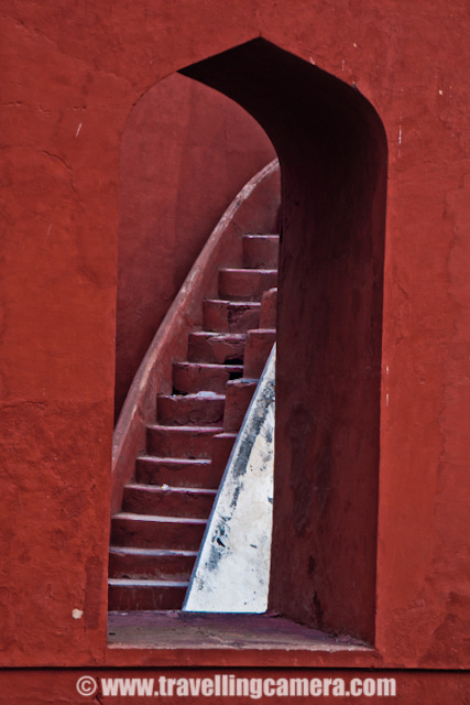 Some Experiments with old architecture of Jantar Mantar in Delhi, INDIA : Posted by VJ SHARMA on www.travellingcamera.com : Last month me and one of my friend were waiting for other folks to reach Connaught Place in Delhi and they called us to inform that all of them are arriving after 1:30 Hrs... This was good opportunity for us to explore some place nearby and decided to visit Jantar Mantar... After reaching the place I was not able to decide what should I shoot... Everywhere people were roaming and it was really difficult to find a place without people... and it was not like two or three folks.. It was huge crowd in front of each yantra @ Jantar Mantar.. So finally I decided to have some photographs which can avoid this crowd and it gave a good opportunity to place with various angles/compositions... check out and critics are welcome !!The first photograph where I wanted to have darkest possible shadows to make it look like black tiles in contact with reds and white ones.. Although it doesn't look like that... I would have to wait to click this photograph at right time but we had to move out in few hrs... Never mind, I will try it again...This time I was carrying SONY Alpha-700 and was confused with some of the controls.. Anyway that's not important... These yantras were very narrow is shape and it was difficult to fit myself for clicking these architecture forms nicely... Here is a tilted view of a semi-spherical yantra @ Jantar Mantar...All these photographs from the same yantra and it was was quite interesting... But please don't ask me about how it functions and what it is supposed to do...Stairs hidden behind these structures and everyone needs to follow them to go down and see the real work inside these yantras.. In Jantar Mantar at jaipur, everyone was not allowed to go inside these structures but in Delhi I didn't see such restrictions except one which had highest structure followed by lot of stairs....Jantar Mantar in Delhi is a very popular place among activists, social associations and artists as well... Many of the NGOs choose this place to start a rally or protest... Also many artists have explored this very well and many times Photographers have exhibited this place...A Series of small pillars taking all the weight of small paths connecting outer circle of a structure with a pole in the middle... as you can see the turning path in a circle...One of my friend called it 'Stairs of Success'.. I don't if that is the name of these stairs but like the caption :)Final Photograph showing the close-up view of this architecture which shows the age of this structure and its been repaired multiple times in past which resulted in this roughness... I am again planning to visit Jantar Mantar in Delhi and will ensure that I get full day to spend there...