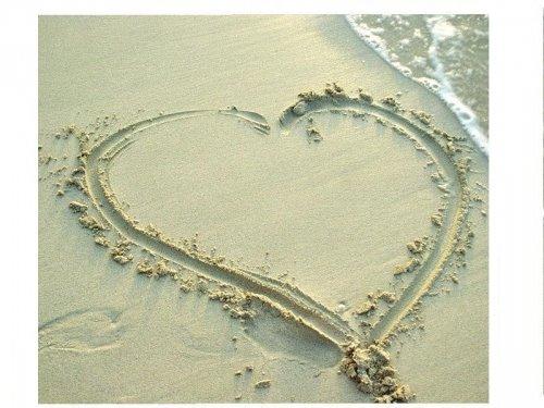 Lovely Heart in Sea Sand