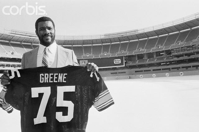 Steeler defensive tackle Joe Greene displays his number 75 jersey ...