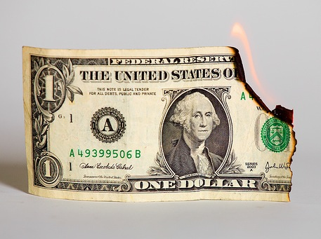 Bad Omen: Egan Jones Slashes U.S. Credit Rating in Response to Feds QE burning dollar