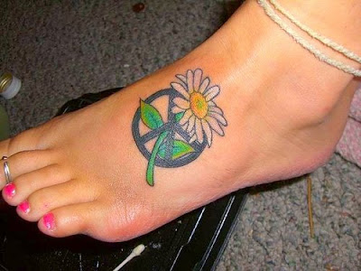 Awesome peace sign with a daisey on foot tattoo