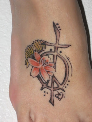 Beautiful peace sign-cross tattoo and flowers. Posted by bajol at 1:54 AM