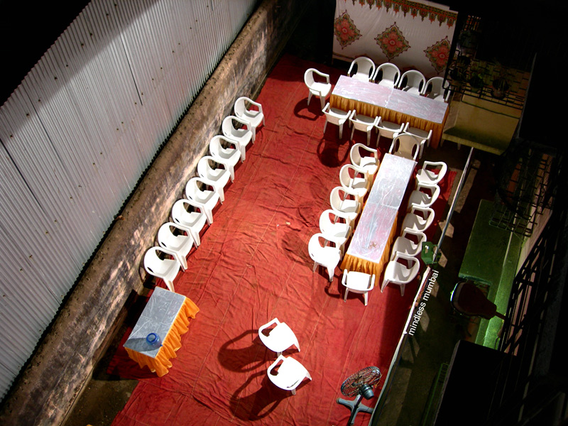 chairs laid out for a gathering in mumbai, india by kunal bhatia