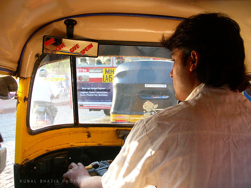 funny sign in an auto rickshaw in mumbai by kunal bhatia