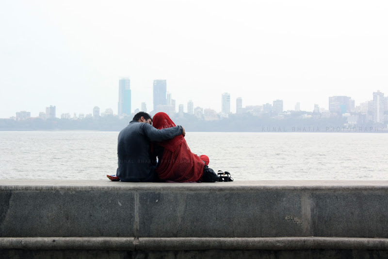 Couples sitting at Marine Drive in Mumbai. Recreation open space sunday evening activity photo by Kunal Bhatia
