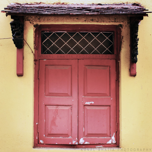 red window and yellow wall at khotachi wadi vernacular architecture in mumbai