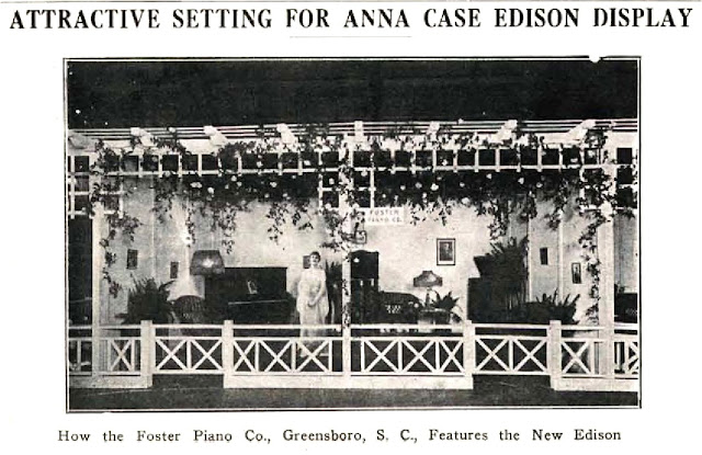 Photograph of an oin-store display for the Edison Diamond Disc phonograph featuring a lif-size cut-out of Anna Case.