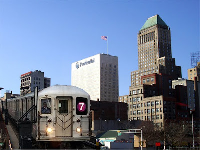 New York City's 7 train with the Newark skyline in the background