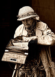 Elderly lady searching handbag