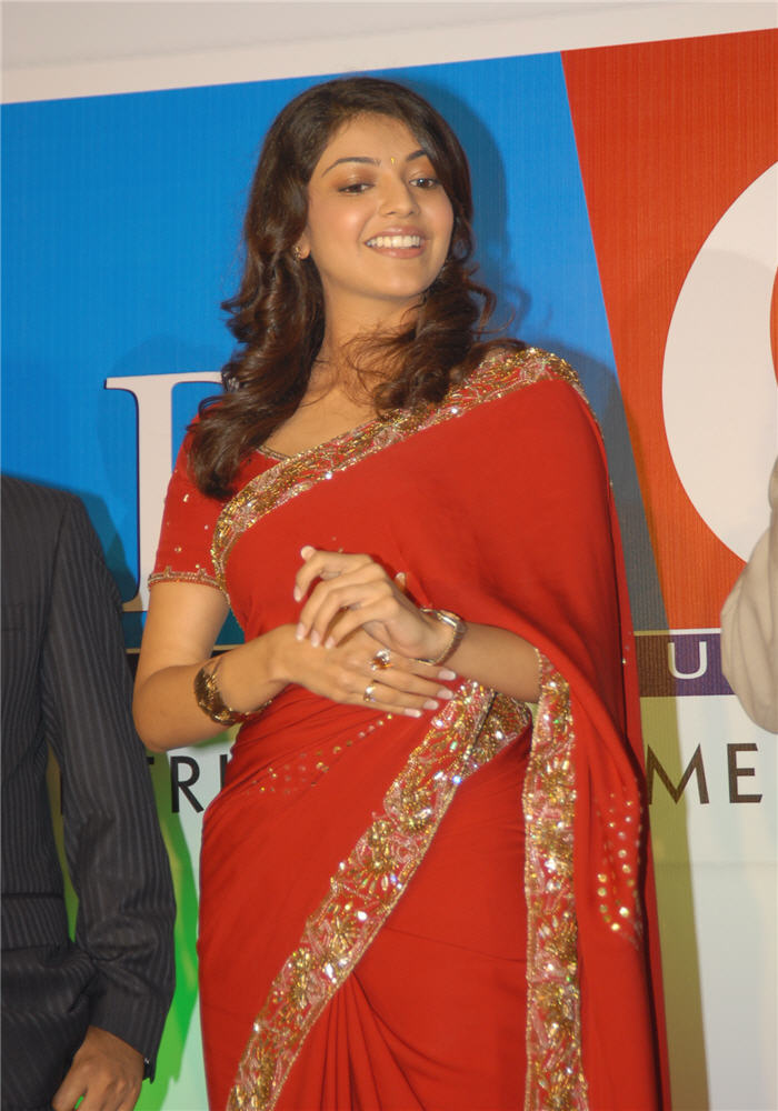 magadheera heroine kajal agarwal big c wearing red saree latest photos