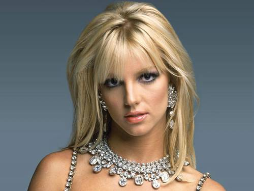 Britney Spears in Long Layered Hairstyle With Bangs
