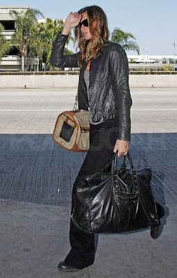 Gie Brunchen Travels With Her Black Giant Balenciaga Weekender