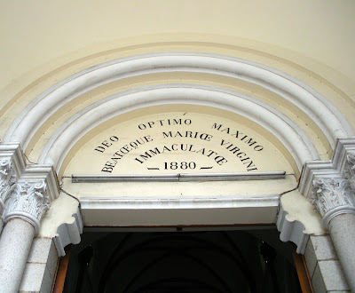 Inscription above entrance of Saigon Notre-Dame cathedral