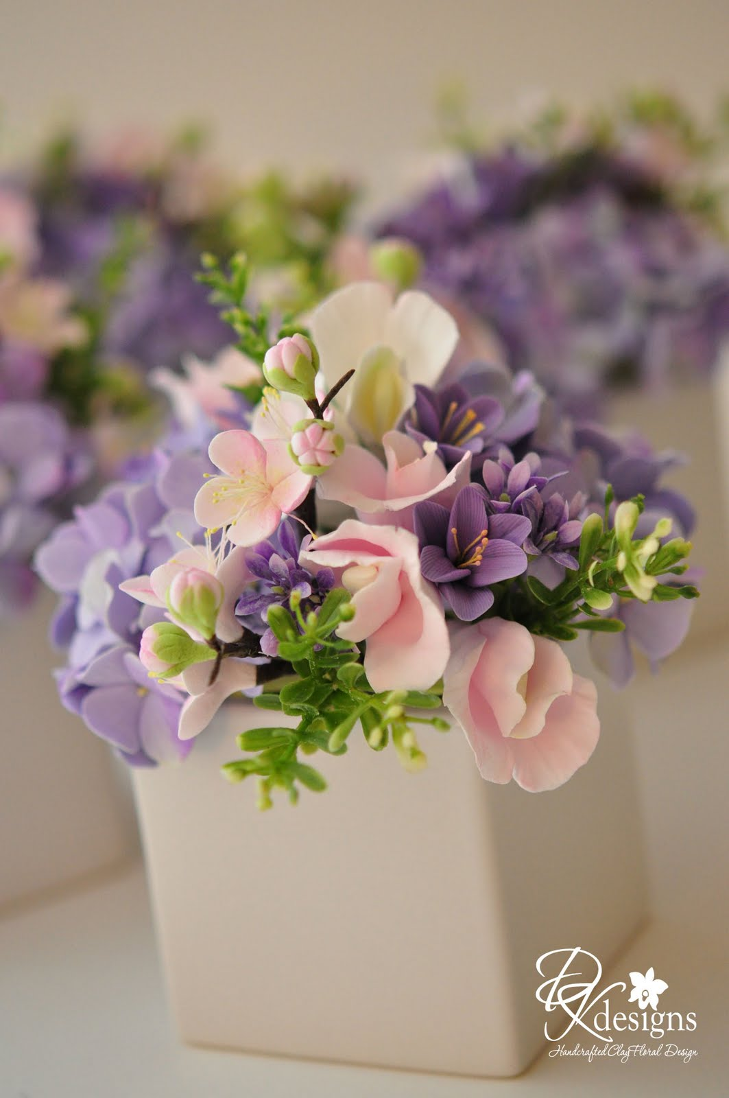 Line floral arrangements down your table―if you don't have enough vases, cake tins, jelly molds, and small ice buckets make surprisingly pretty containers.