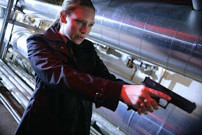 FRINGE: Olivia (Anna Torv) tracks a suspect in the FRINGE episode The Equation