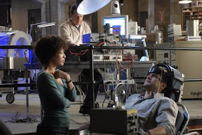 Walter (John Noble, C) and Astrid (Jasika Nicole, L) observe Peter (Joshua Jackson, R) during an experiment in the FRINGE episode 'In Which We Meet Mr. Jones'
