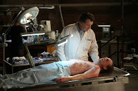 FRINGE: Walter (John Noble) examines a man who fell to his death from the Massive Dynamic building in the FRINGE episode The Dreamscape