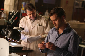 FRINGE: Walter (John Noble, L) and Peter (Joshua Jackson, R) examine a man who fell to his death from the Massive Dynamic building in the FRINGE episode The Dreamscape