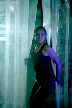 Olivia (Anna Torv) searches an abandonded warehouse in the FRINGE episode Bound
