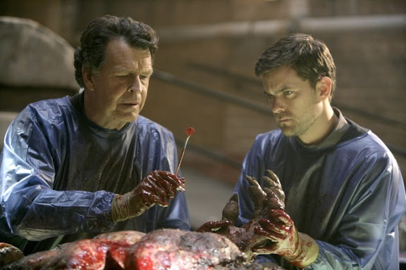 FRINGE: Walter (John Noble, L) and Peter (Joshua Jackson, L) discover a familiar looking chip in human remains in the FRINGE episode The Transformation