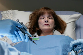 FRINGE: Nina (Blair Brown) fights to stay alive in the FRINGE season finale episode 'There's More Than One of Everything' airing Tuesday, May 12 (9:01-10:00 PM ET/PT) on FOX. ©2009 Fox Broadcasting Co. CR: Craig Blankenhorn/FOX