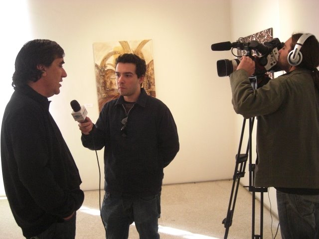 The Artist and curator of the exhibition Francisco Urbano giving an interview to TV