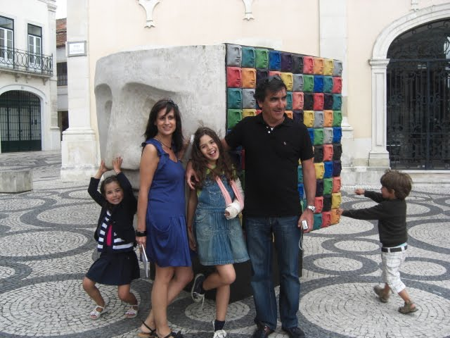 Carla, Urbano and staff near a public sculpture of Queimadela