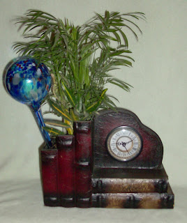 glass watering globe in plant