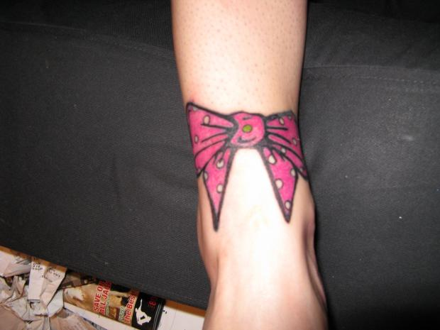 bow tattoos on foot
