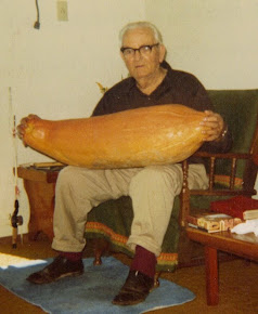 My great-uncle Arlene showing off a Banana Squash he grew sometime in the mid 80&#39;s!
