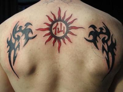 sun tattoo. Tribal Wings and Sun Tattoo