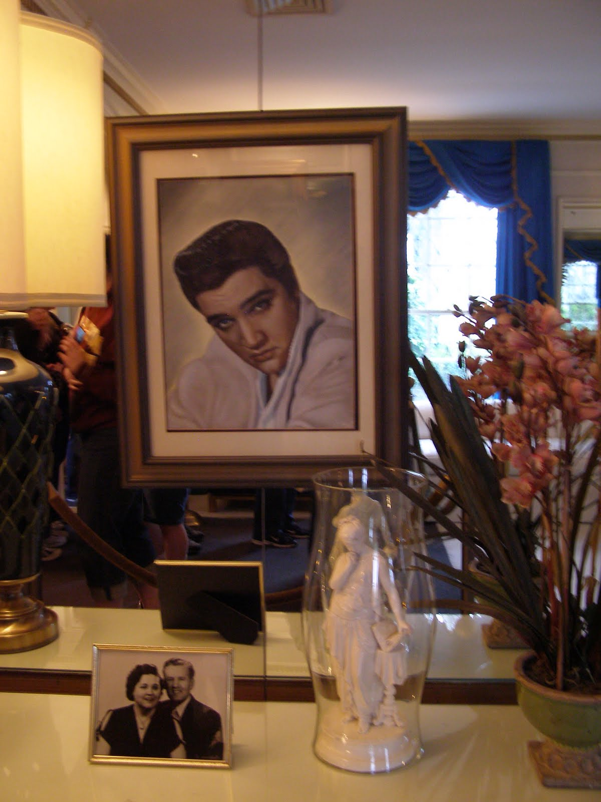 This Picture Of Elvis And His Parents Is In The Hallway Outside The
