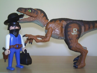 A dinosaur eats a cowboy's hat.