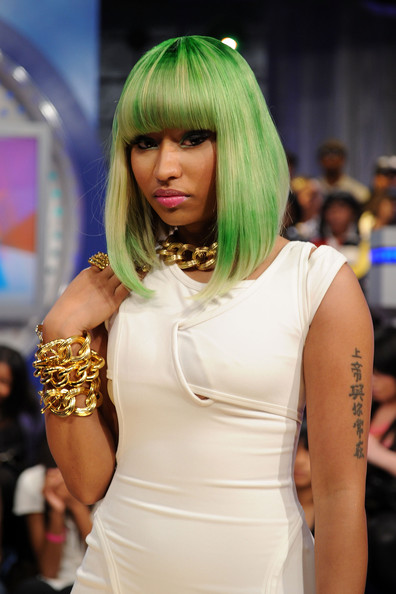 Nicki Minaj is known for her colorful wig and she is not stopping the