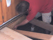 using leverage to install supports under sagging sub-floor (below cabinetry).