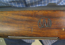 The hand-carved initials of Fred's father grace the stock of this most priceless '03 Mannlicher.